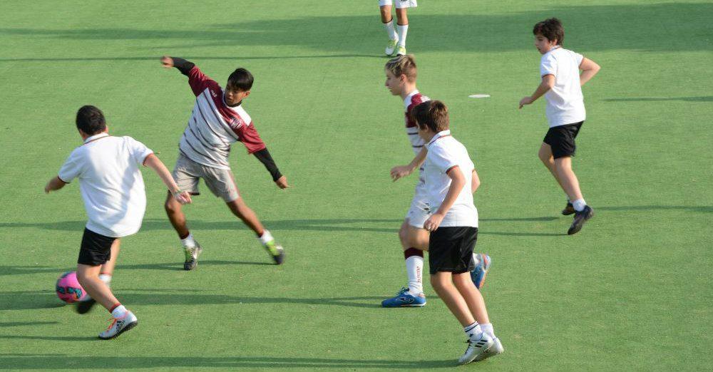 ragazzi in campo che giocano. Phot credit Marta Potenza