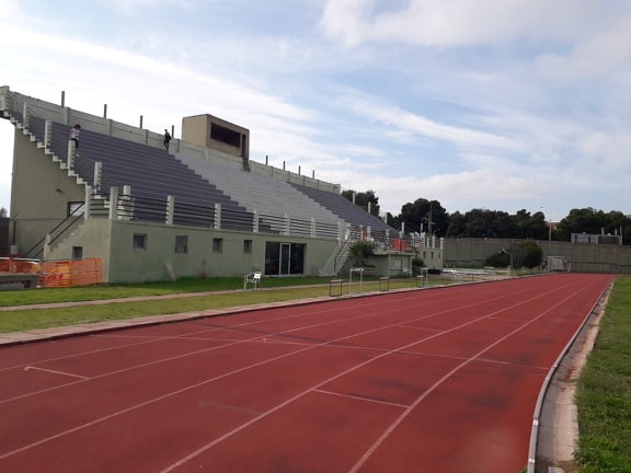 Tribuna Centrale. Sotto, La Pista Di Atletica Leggera.jpg