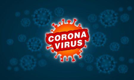 CoronaVirus scritta bianca su particella arancione e sfondo blu