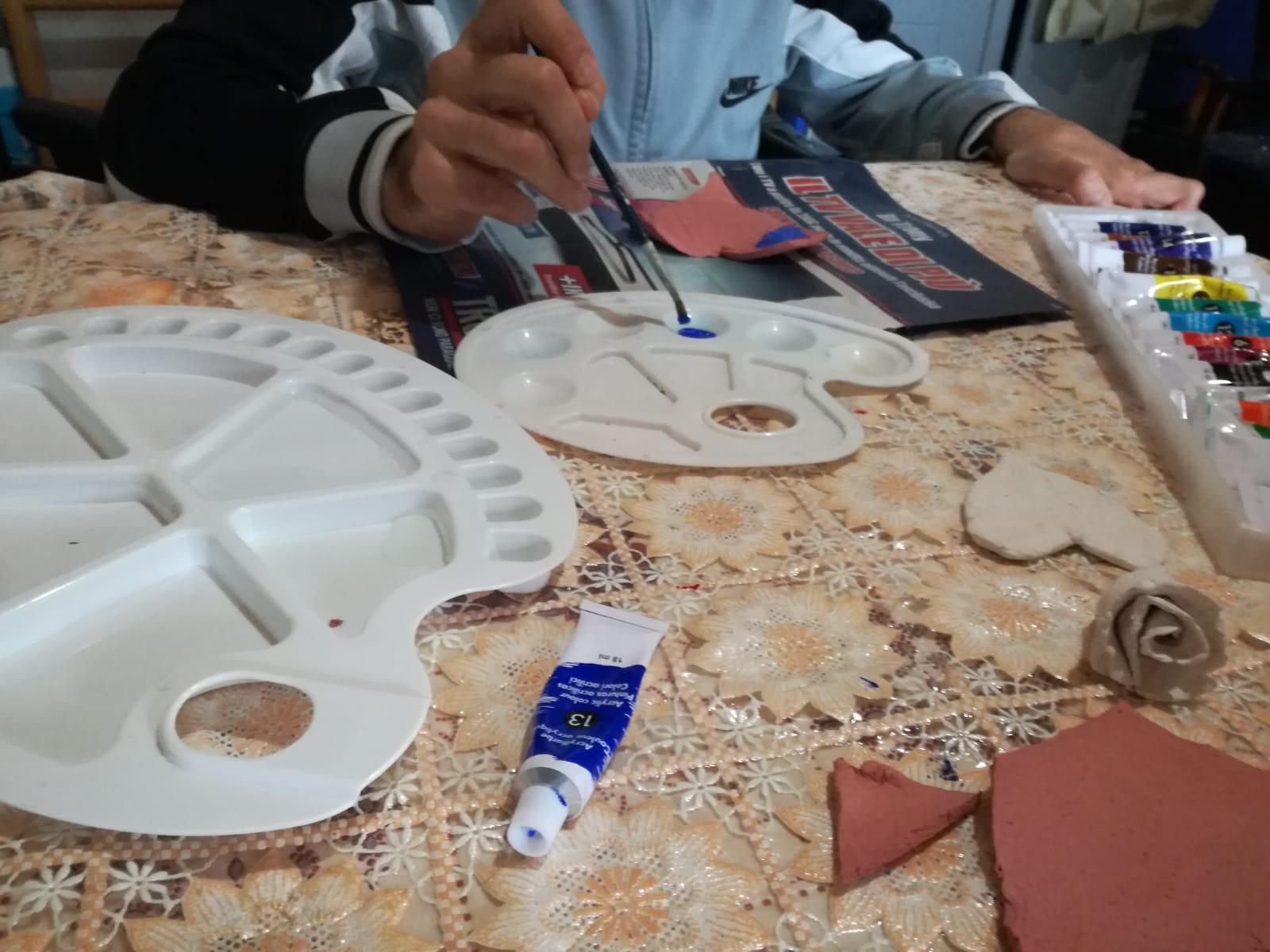 servizio civile - un ragazzo che pittura