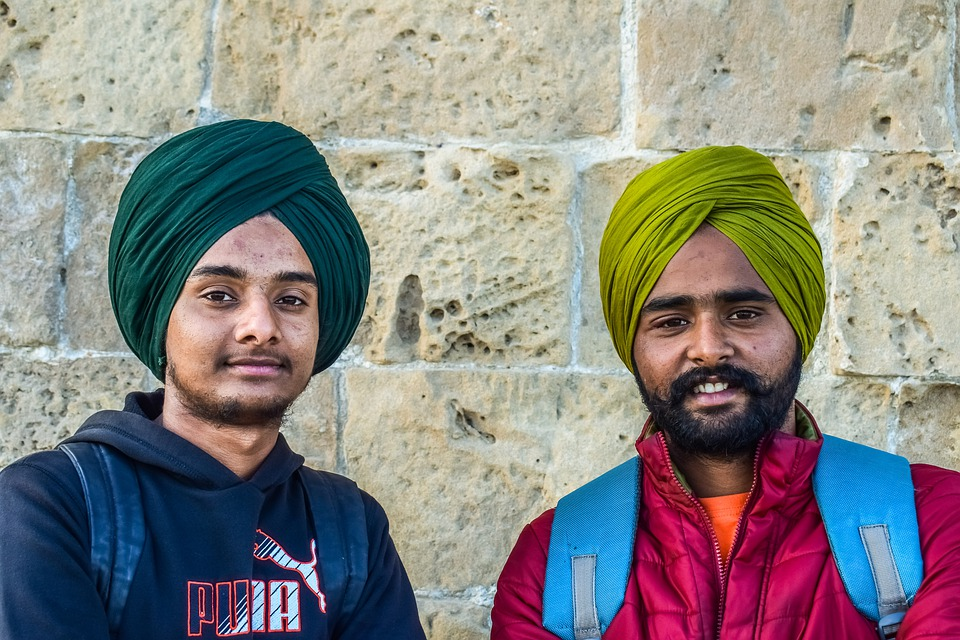 I Sikh pontini - Sikhs in posa sorridenti