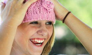 Progetto sogni e bisogni - immagine di Ragazza Con Cappellino Rosa