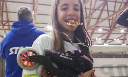 Giorgia Fusetto con la Medaglia D' Oro in bocca