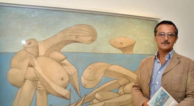 Pablo Picasso e uno dei suoi quadri