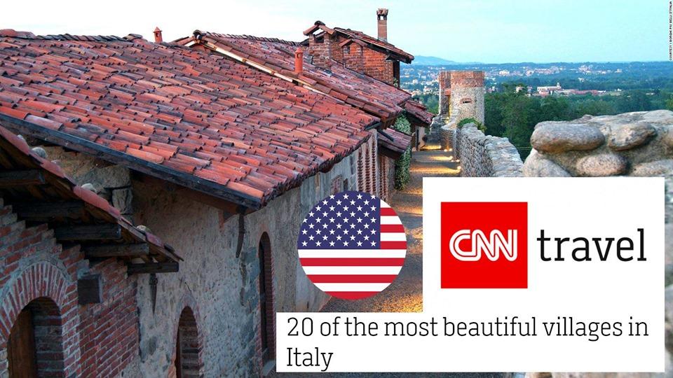 Ricetto Di Candelo al terzo posto nella classifica dei borghi della cnn, immagine dei tetti delle case con gli stemmi della cnn e della bandiera americana